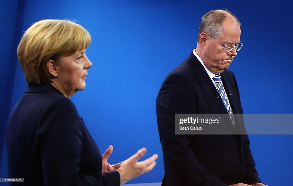 In this screenshot taken from German television German Chancellor and Christian Democrat (CDU) <a gi-track='captionPersonalityLinkClicked' href=/galleries/search?phrase=Angela+Merkel&family=editorial&specificpeople=202161 ng-click='$event.stopPropagation()'>Angela Merkel</a> and Social Democrats (SPD) chancellor candidate <a gi-track='captionPersonalityLinkClicked' href=/galleries/search?phrase=Peer+Steinbrueck&family=editorial&specificpeople=209110 ng-click='$event.stopPropagation()'>Peer Steinbrueck</a> debate live at the Adlershof studios on September 1, 2013 in Berlin, Germany. Today's live debate is the only one between the two candidates ahead of German elections scheduled for September 22.