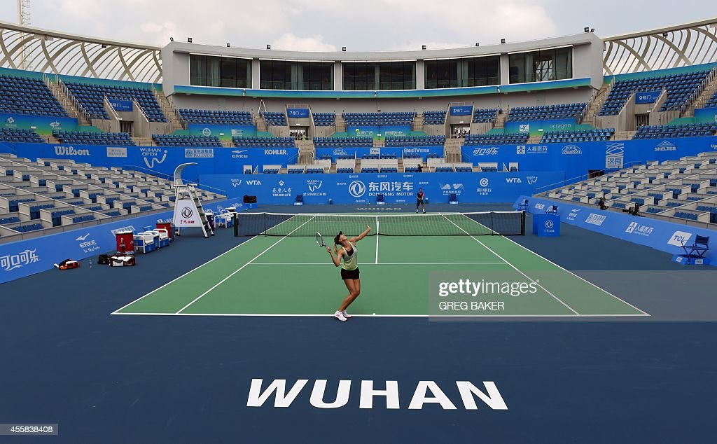 In this Sepember 20 2014 photo Maria Sharapova of Russia practices on center court at the Optics Valley International Tennis Center ahead of the...