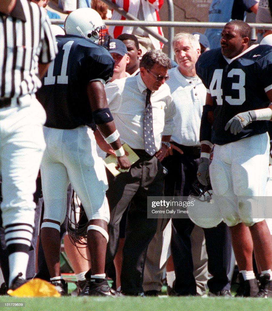 In this September 11, 1999 file photograph, Penn State's LaVar Arrington (11) is talked to by Joe Paterno and Jerry Sandusky, second from right, after a punt in the first quarter. On November 5, 2011, former Penn State defensive coordinator Sandusky was arrested on charges that he preyed on boys he met through The Second Mile, a charity he founded for at-risk youths. He faces charges including seven counts of first-degree involuntary deviate sexual intercourse, all of which are punishable by up to 20 years in prison and a $25,000 fine.