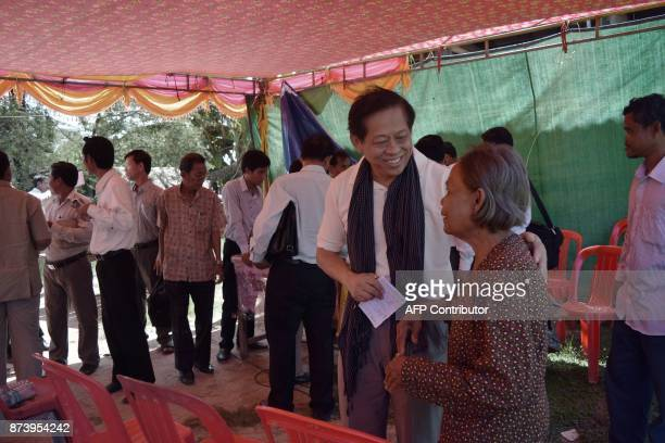 In this September 9 2017 photographLim Kimya a member of the National Assembly from Cambodia National Rescue Party interacts with a woman during a...