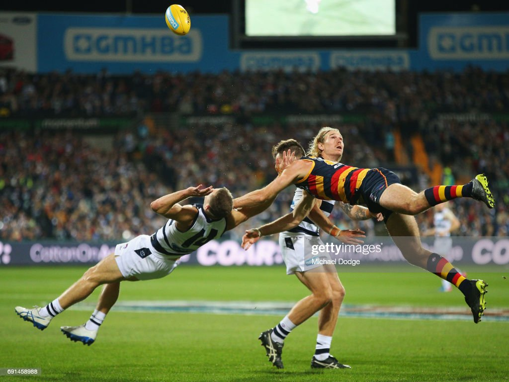 In this series Joel Selwood of the Cats collides with Andy Otten of the Crows after courageously trying to marks the ball during the round 10 AFL match between the Collingwood Magpies and Brisbane Lions at Melbourne Cricket Ground on May 28, 2017 in Melbourne, Australia.