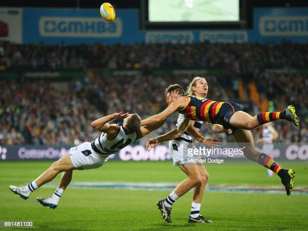 In this series Joel Selwood of the Cats collides with Andy Otten of the Crows after courageously trying to marks the ball during the round 11 AFL...