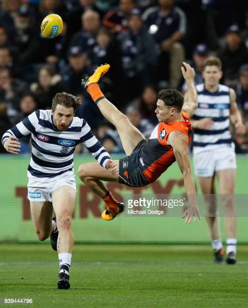 In this series Josh Kelly of the Giants collides with Zach Tuohy of the Cats when competing for the ball during the round 23 AFL match between the...