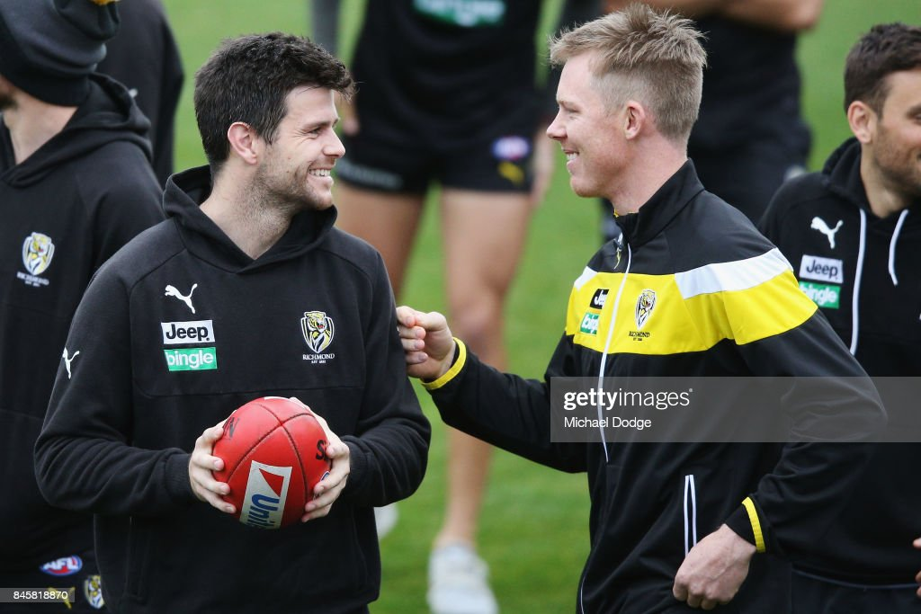 In this series Trent Cotchin reacts after listening carefully to Jack Riewoldt (R) during a Richmond Tigers AFL training session at Punt Road Oval on September 12, 2017 in Melbourne, Australia.