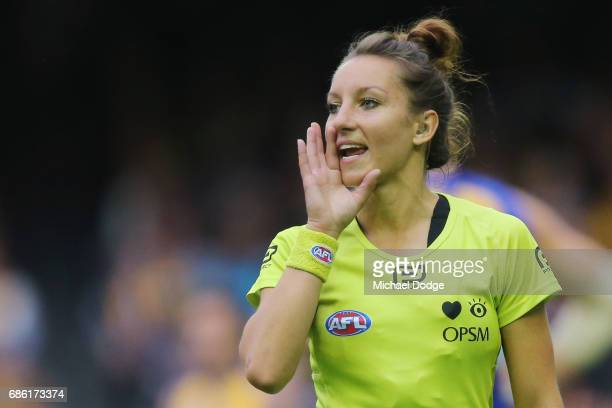 In this series Umpire Ellen Glouftsis making her debut as the first ever women to umpire an AFL match shouts instructions during the round nine AFL...