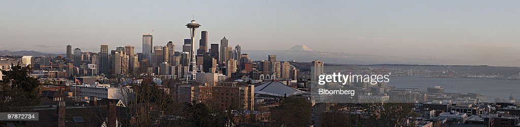 In this six image composite, Mt. Rainier stands beyond buildings in the skyline of Seattle, Washington, U.S., on Wednesday, March 17, 2010. In a report released March 19, 2010 by the U.S. Labor Department, Seattle had an unemployment rate of 9.6% in January, up from 9% in December 2009. Photographer: Daniel Acker/Bloomberg via Getty Images