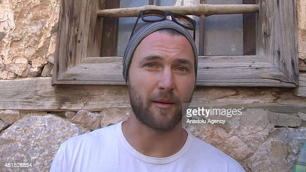 In this still image taken from a video on July 21 2015 show that American base jumper Ian Flanders before an accident happened while jumping from a...