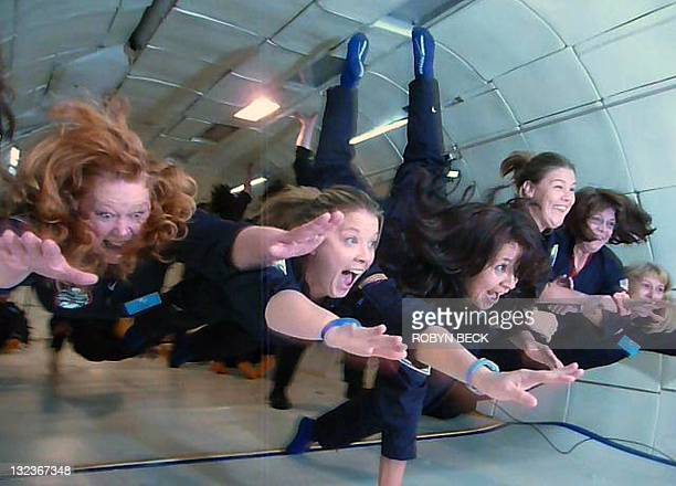 In this still photograph from video school teachers react as they experience zero gravity during a parabolic flight aboard a Boeing 727 aircraft...
