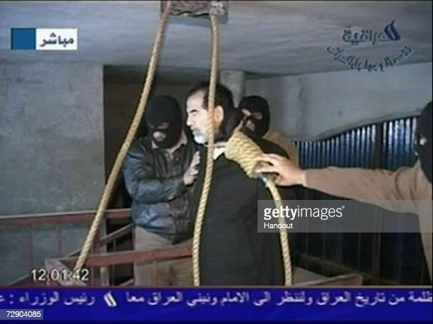 In this television screen grab taken from Iraqi national television station Aliraqia a video shows the moments leading up to the execution of former...