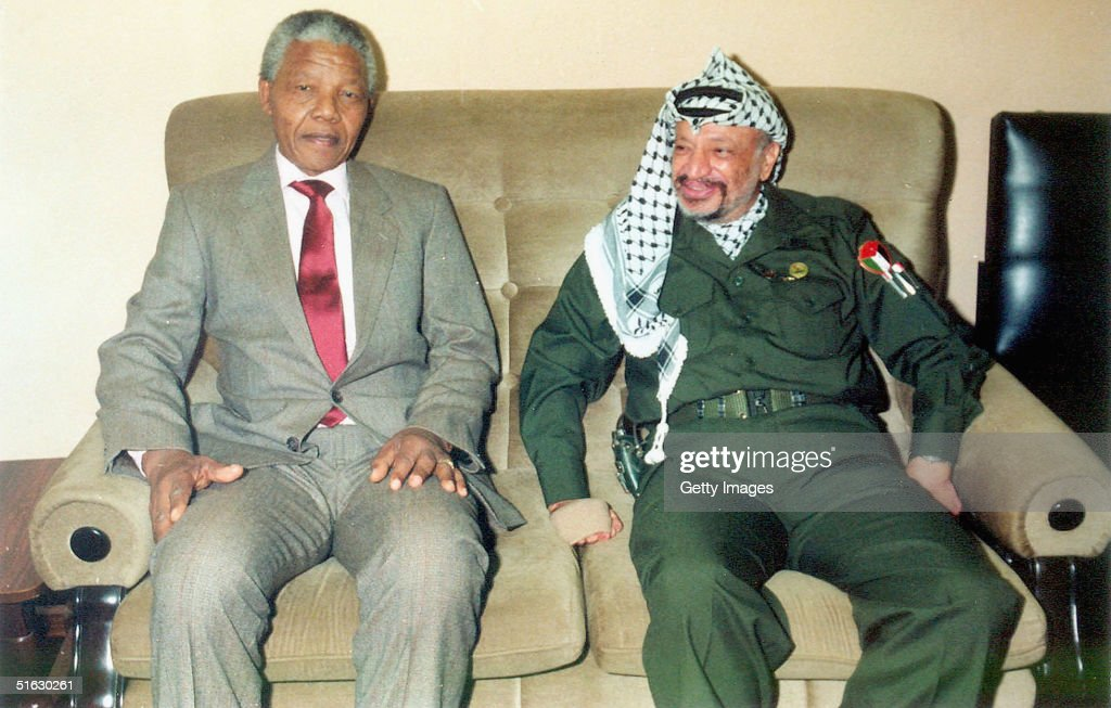 In this undated file photo Palestinian leader Yasser Arafat is pictured meeting with <a gi-track='captionPersonalityLinkClicked' href=/galleries/search?phrase=Nelson+Mandela&family=editorial&specificpeople=118613 ng-click='$event.stopPropagation()'>Nelson Mandela</a> the former leader of South Africa. Medics announced on October 31, 2004 that Arafat's health is in a serious condition, after the illness that has persisted for two weeks, took a sudden turn for the worse. Test have so far proved inconclusive and more results are expected on Wednesday.