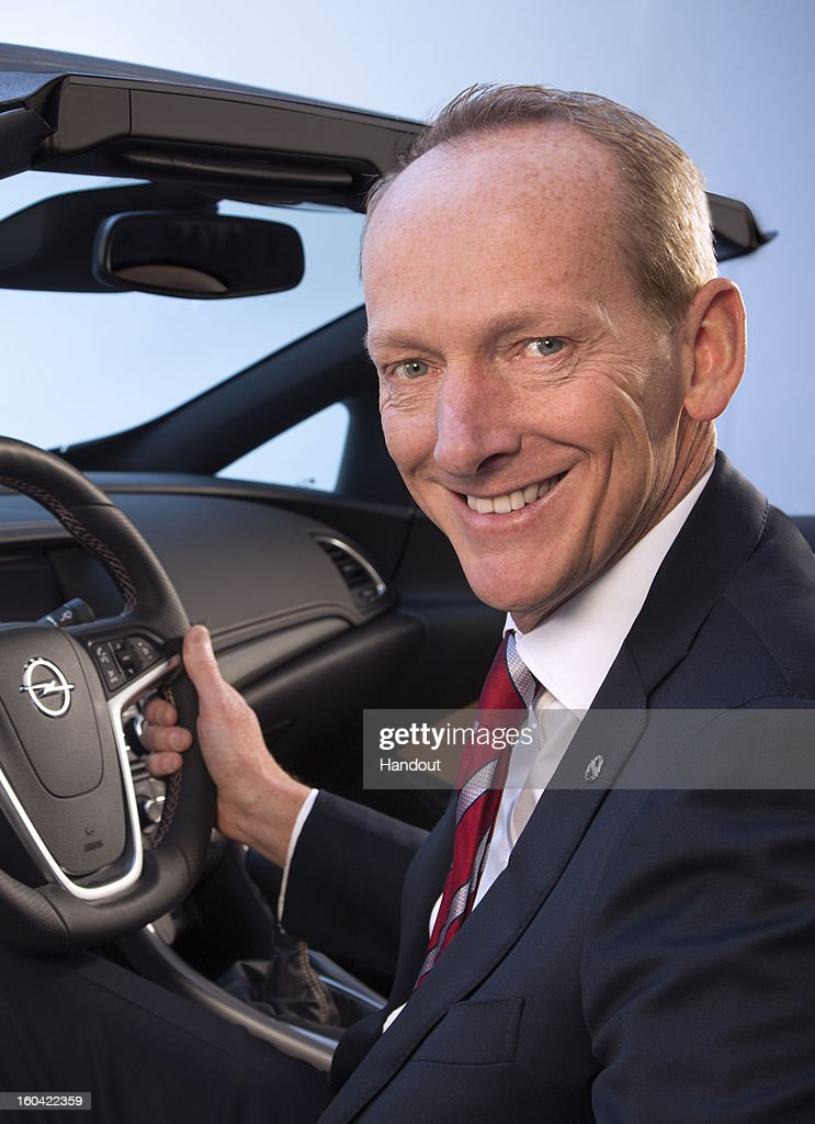 In this undated handout image provided by GM Company, Karl-Thomas Neumann poses in an Opel car as it is announced today he will become Chairman of the Management Board of Adam Opel AG effective March 1, 2013. In addition GM appointed Neumann President and Vice President of GM Europe and GM.