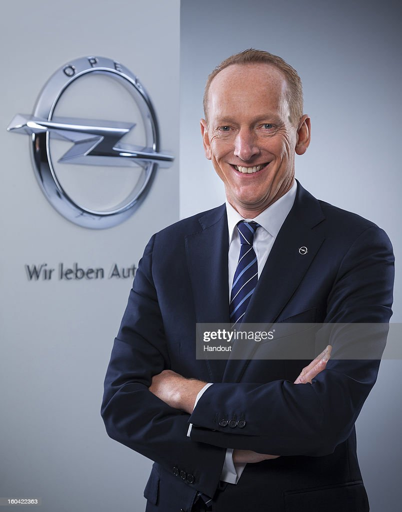 In this undated handout image provided by GM Company, Karl-Thomas Neumann poses in front of an Opel logo as it is announced today he will become Chairman of the Management Board of Adam Opel AG effective March 1, 2013. In addition GM appointed Neumann President and Vice President of GM Europe and GM.
