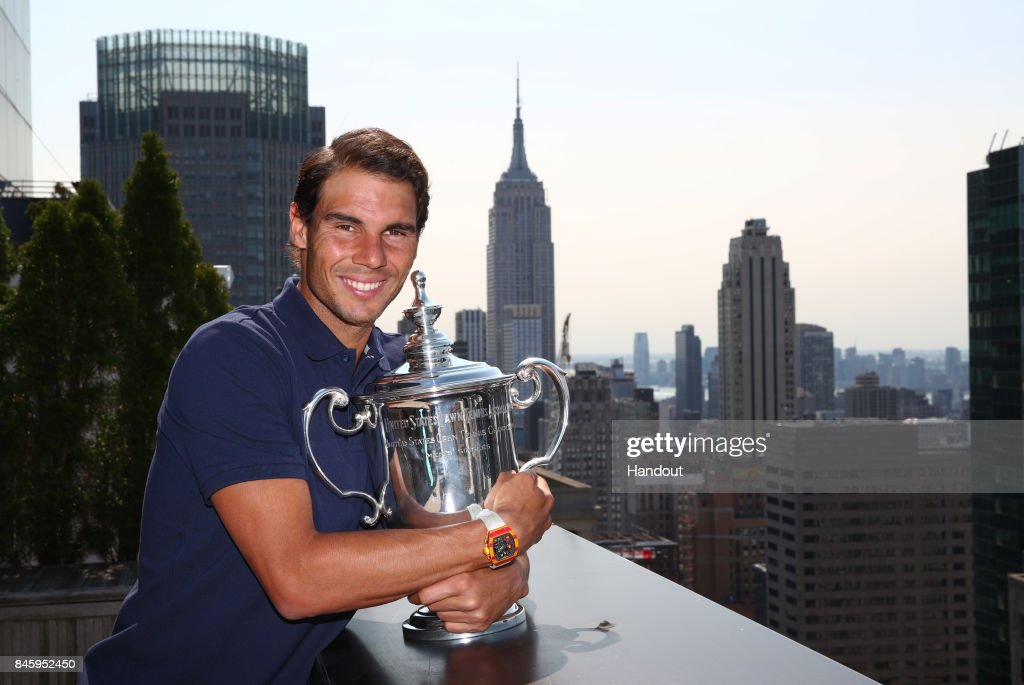 In this undated handout image Rafael Nadal of Spain, the 2017 US Open Men's Singles champion, poses with the winner's trophy in New York City.