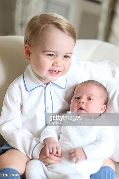 In this undated handout image released by the Duke and Duchess of Cambridge Prince George and Princess Charlotte at Anmer Hall in midMay in Norfolk...