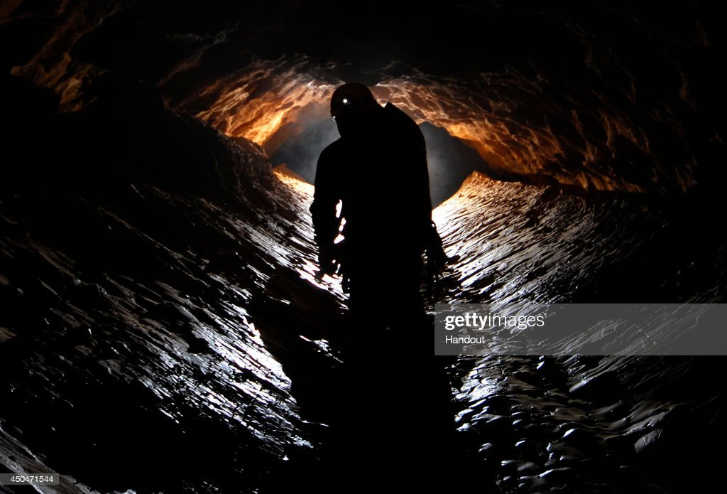 In this undated handout photo a spelunker explores the Riesending cave where an explorer is currently lying injured 1,000 meters below since June 8, 2014 near Marktschellenberg, Germany. The man, along with two colleagues, was exploring the Riesending vertical cave, which is over 20km long and up to 1,148 meters deep, when he was struck by rocks and severely injured. Since then specialist rescue workers from Switzerland and Italy have arrived to help with the arduous rescue effort, which could take up to several more days and even weeks.