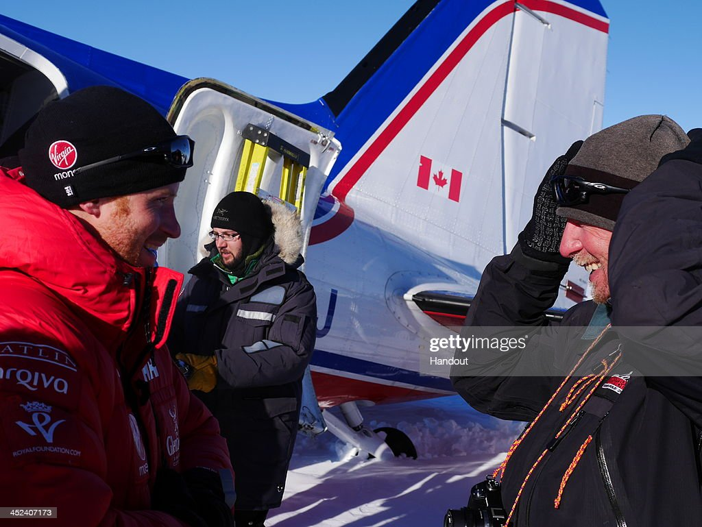 In this undated handout photo issued on November 28, 2013 and provided by Walking with the Wounded (WWTW), Prince Harry (L) talks to Team Guide Conrad Dickinson (R) as equipment is unloaded from a plane during the Walking with the Wounded South Pole Allied Challenge. The Virgin Money South Pole Allied Challenge 2013, of which Harry is patron, will see the participants race across three degrees to the South Pole. All 12 injured service personnel from Britain, America, Canada and Australia have overcome life-changing injuries and undertaken challenging training programmes to prepare themselves for the conditions they will face in Antarctica. Trekking around 15km to 20km per day, the teams will endure temperatures as low as minus 45C and 50mph winds as they pull their 70kg sleds to the south pole. This handout photo may only be used in for editorial reporting purposes for the contemporaneous illustration of events, things or the people in the image or facts mentioned in the caption. Reuse of the picture may require further permission from the copyright holder.