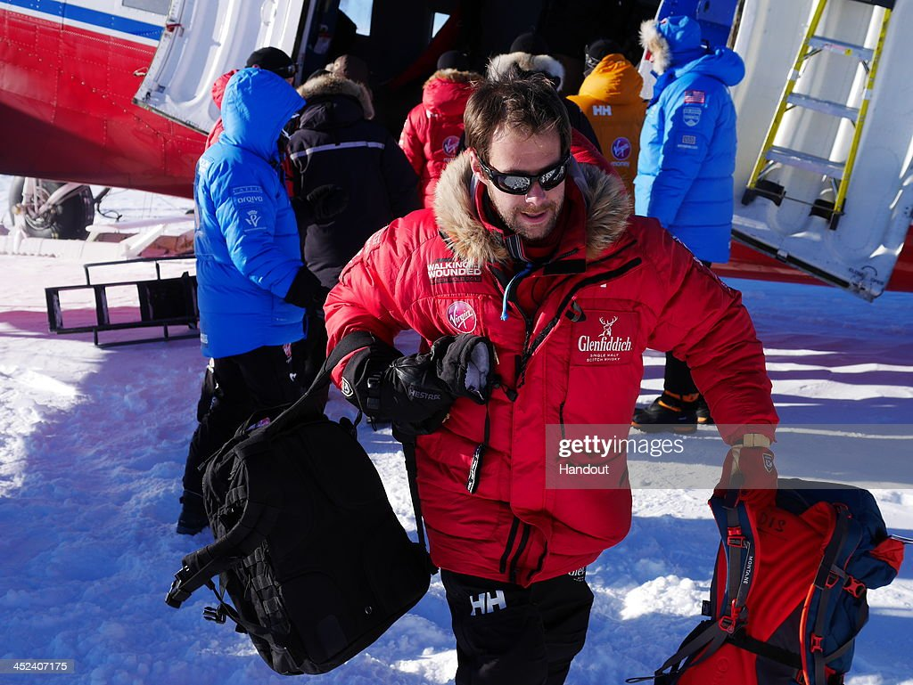 In this undated handout photo issued on November 28, 2013 and provided by Walking with the Wounded (WWTW), team member Guy Disney unloads equipment from a plane during the Walking with the Wounded South Pole Allied Challenge. The Virgin Money South Pole Allied Challenge 2013, of which Harry is patron, will see the participants race across three degrees to the South Pole. All 12 injured service personnel from Britain, America, Canada and Australia have overcome life-changing injuries and undertaken challenging training programmes to prepare themselves for the conditions they will face in Antarctica. Trekking around 15km to 20km per day, the teams will endure temperatures as low as minus 45C and 50mph winds as they pull their 70kg sleds to the south pole. This handout photo may only be used in for editorial reporting purposes for the contemporaneous illustration of events, things or the people in the image or facts mentioned in the caption. Reuse of the picture may require further permission from the copyright holder.