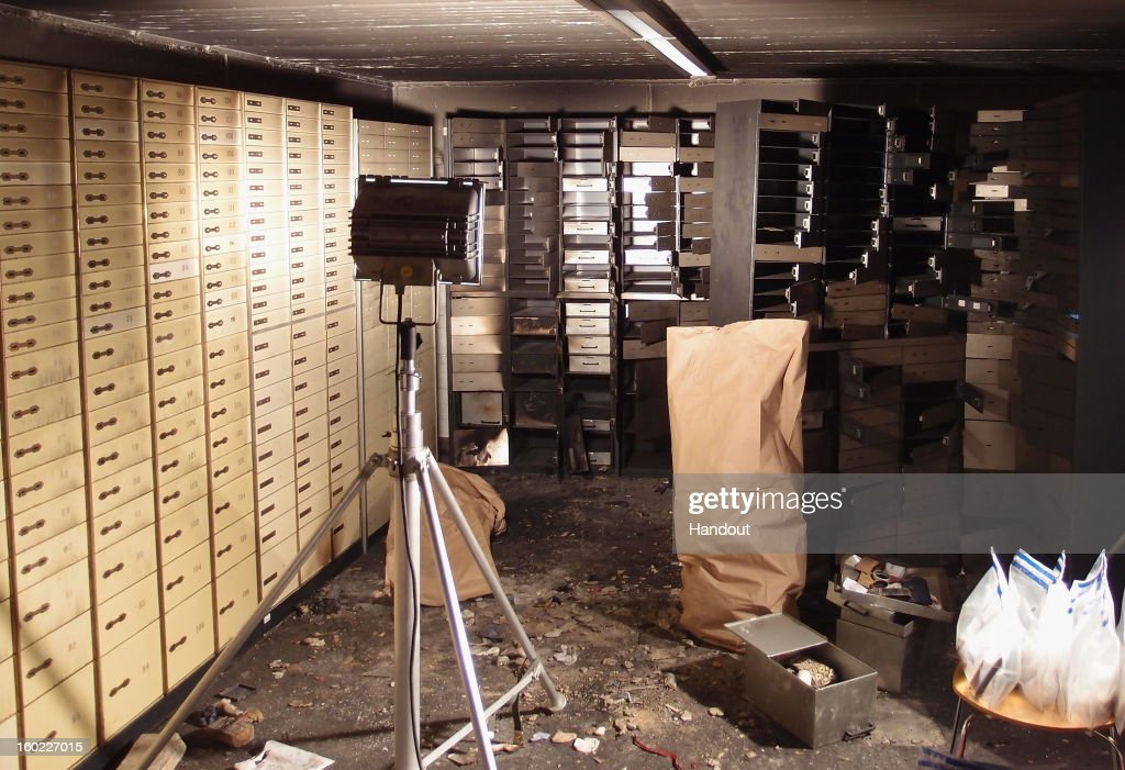 In this undated handout photo, made available January 28, 2013 and provided by the Berliner Volksbank, safety deposit boxes remain open in the vault of the Steglitz district bank shortly after police investigators finished searching for clues following a robbery. The robbers dug a 45 meter long tunnel from an adjacent underground parking garage on January 13, 2013 to reach the vault and steal an unknown loot.