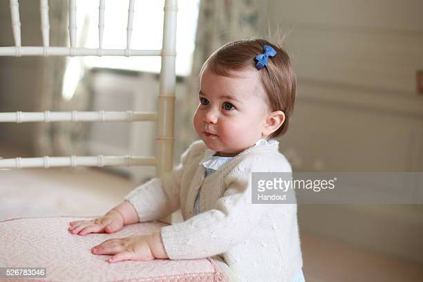 In this undated handout photo provided by HRH The Duke and Duchess of Cambridge released on May 1 Princess Charlotte of Cambridge looks up with her...