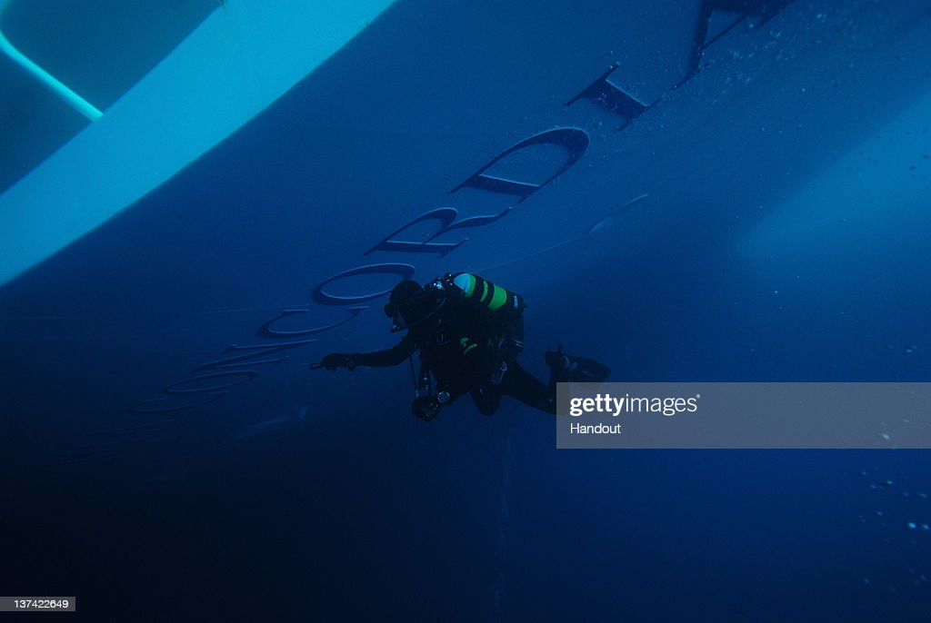 In this undated handout photo provided by Ufficio Stampa Gruppo Carabinieri Subaquei, Carabinieri frogmen dive on the cruise ship Costa Concordia, January, 2012 in Giglio Porto, Italy. The rescue operation to find 21 people still missing aboard the Costa Concordia has resumed on January 20, 2011 after being suspended for the third time, as conditions caused the vessel to shift on the rocks on which it is resting.