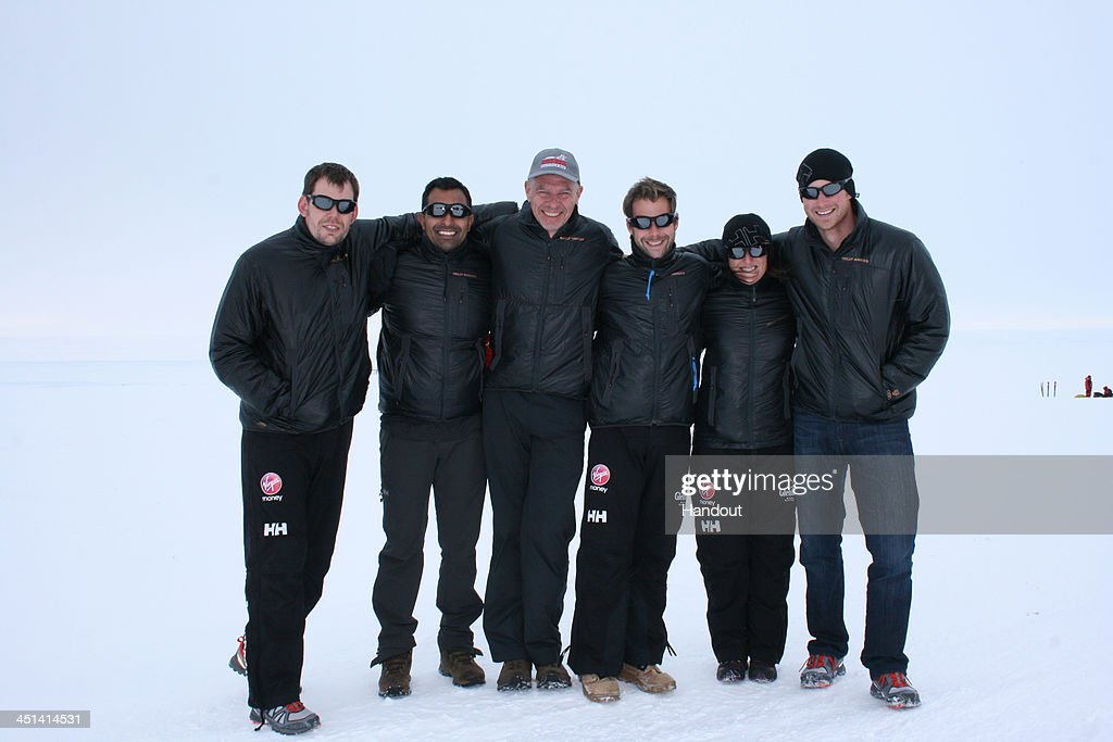NOVO, ANTARCTICA - In this undated handout photo provided by Walking with the Wounded (WWTW) on November 22, 2013, (right to left) <a gi-track='captionPersonalityLinkClicked' href=/galleries/search?phrase=Prince+Harry&family=editorial&specificpeople=178173 ng-click='$event.stopPropagation()'>Prince Harry</a>, Kate Philp, Guy Disney, Richard Eyre, Ibrar Ali and Duncan Slater of Team UK in the Virgin Money South Pole Allied Challenge expedition arrposes together on arrival at Novo, Antarctica. The team of 12 injured service personnel from Britain, America, Canada and Australia have overcome life-changing injuries and undertaken challenging training programmes to prepare themselves for the conditions they will face in Antarctica. Trekking around 15km to 20km per day, the teams will endure temperatures as low as minus 45C and 50mph winds as they pull their 70kg sleds to the south pole. (Photo by WWTW via Getty Images)NOTE