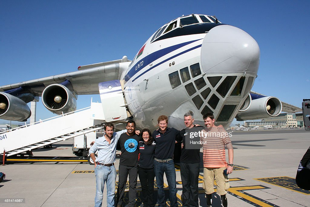 AFRICA - In this undated handout photo provided by Walking with the Wounded (WWTW) on November 22, 2013, (left to right) Guy Disney, Ibrar Ali, Kate Philp, Prince Harry, Richard Eyre and Duncan Slater pose at the start of the Virgin Money South Pole Allied Challenge 2013 expedition as they leave Cape Town for a flight to Novo, Antarctica. The team of 12 injured service personnel from Britain, America, Canada and Australia have overcome life-changing injuries and undertaken challenging training programmes to prepare themselves for the conditions they will face in Antarctica. Trekking around 15km to 20km per day, the teams will endure temperatures as low as minus 45C and 50mph winds as they pull their 70kg sleds to the south pole. This handout photo may only be used in for editorial reporting purposes for the contemporaneous illustration of events, things or the people in the image or facts mentioned in the caption. Reuse of the picture may require further permission from the copyright holder.