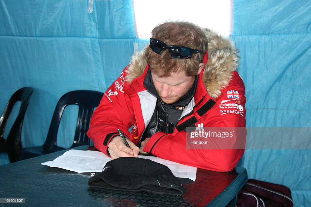 NOVO, ANTARCTICA - In this undated handout photo provided by Walking with the Wounded (WWTW) on November 23, 2013, Prince Harry, patron of Team UK in the Virgin Money South Pole Allied Challenge 2013 expedition, makes notes of how much each individual and their kit weighs during preparations, in Novo, Antarctica. The team of 12 injured service personnel from Britain, America, Canada and Australia have overcome life-changing injuries and undertaken challenging training programmes to prepare themselves for the conditions they will face in Antarctica. Trekking around 15km to 20km per day, the teams will endure temperatures as low as minus 45C and 50mph winds as they pull their 70kg sleds to the south pole. This handout photo may only be used in for editorial reporting purposes for the contemporaneous illustration of events, things or the people in the image or facts mentioned in the caption. Reuse of the picture may require further permission from the copyright holder.
