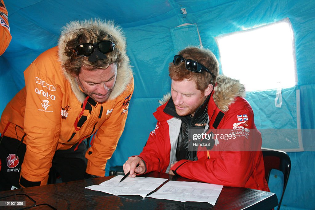 NOVO, ANTARCTICA - In this undated handout photo provided by Walking with the Wounded (WWTW) on November 23, 2013, <a gi-track='captionPersonalityLinkClicked' href=/galleries/search?phrase=Prince+Harry&family=editorial&specificpeople=178173 ng-click='$event.stopPropagation()'>Prince Harry</a>, patron of Team UK in the Virgin Money South Pole Allied Challenge 2013 expedition, and <a gi-track='captionPersonalityLinkClicked' href=/galleries/search?phrase=Dominic+West&family=editorial&specificpeople=211555 ng-click='$event.stopPropagation()'>Dominic West</a> make notes of how much each individual and their kit weighs, during preparations in Novo, Antarctica. The team of 12 injured service personnel from Britain, America, Canada and Australia have overcome life-changing injuries and undertaken challenging training programmes to prepare themselves for the conditions they will face in Antarctica. Trekking around 15km to 20km per day, the teams will endure temperatures as low as minus 45C and 50mph winds as they pull their 70kg sleds to the south pole. (Photo by WWTW via Getty Images)