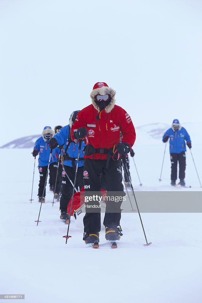 NOVO, ANTARCTICA - In this undated handout photo provided by Walking with the Wounded (WWTW) on November 25, 2013, Prince Harry, patron of Team UK in the Virgin Money South Pole Allied Challenge 2013 expedition, pulling the pulk which is guiding US team member Ivan Castro, who is blind, as he takes part in ski training near Novo, Antarctica. The Virgin Money South Pole Allied Challenge 2013, of which Harry is patron, will see the participants race across three degrees to the South Pole. All 12 injured service personnel from Britain, America, Canada and Australia have overcome life-changing injuries and undertaken challenging training programmes to prepare themselves for the conditions they will face in Antarctica. Trekking around 15km to 20km per day, the teams will endure temperatures as low as minus 45C and 50mph winds as they pull their 70kg sleds to the south pole. This handout photo may only be used in for editorial reporting purposes for the contemporaneous illustration of events, things or the people in the image or facts mentioned in the caption. Reuse of the picture may require further permission from the copyright holder.