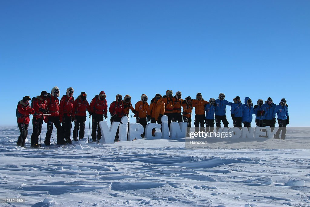 NOVO, ANTARCTICA - In this undated handout photo provided by Walking with the Wounded (WWTW) on December 3, 2013, The Walking With The Wounded teams pose for a photograph in Antarctica on day one of the South Pole Allied Challenge. The Virgin Money South Pole Allied Challenge 2013, of which Harry is patron, will see the participants race across three degrees to the South Pole. All 12 injured service personnel from Britain, America, Canada and Australia have overcome life-changing injuries and undertaken challenging training programmes to prepare themselves for the conditions they will face in Antarctica. Trekking around 15km to 20km per day, the teams will endure temperatures as low as minus 45C and 50mph winds as they pull their 70kg sleds to the south pole.