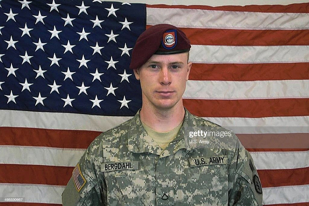 UNDATED - In this undated image provided by the U.S. Army, Sgt. Bowe Bergdahl poses in front of an American flag. U.S. officials say Bergdahl, the only American soldier held prisoner in Afghanistan, was exchanged for five Taliban commanders being held at Guantanamo Bay, Cuba, according to published reports. Bergdahl is in stable condition at a Berlin hospital, according to the reports.