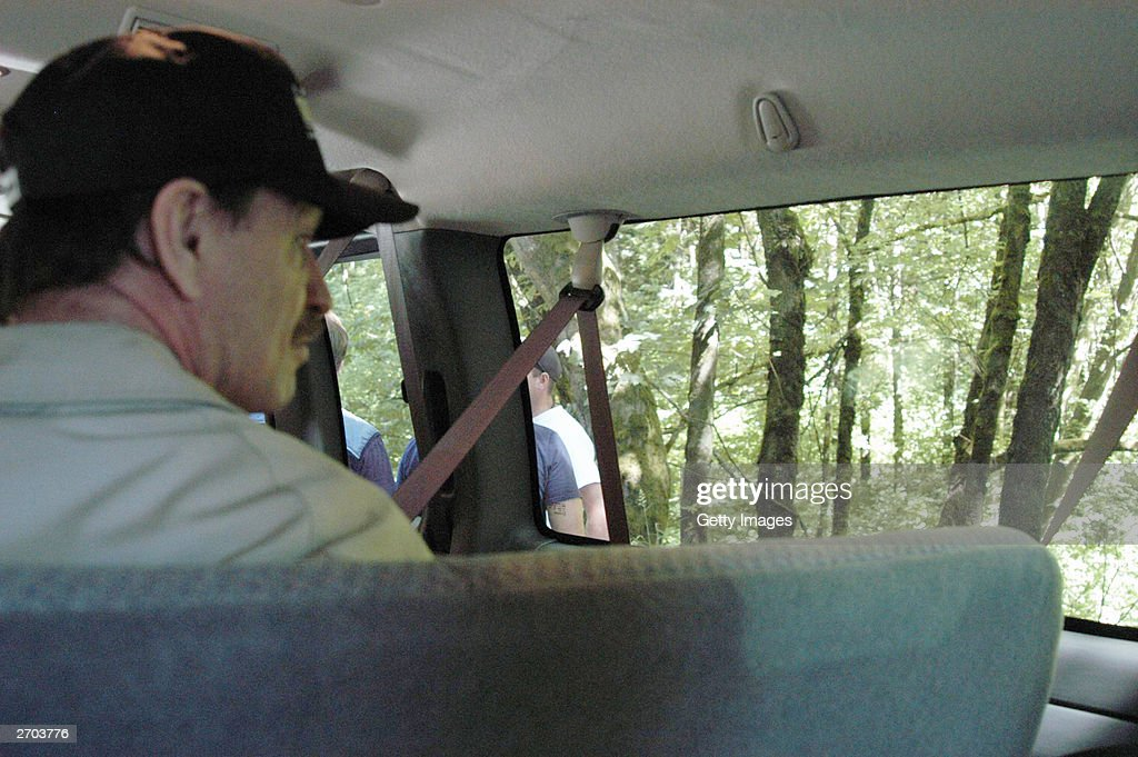 In this undated King County Prosecutor's Office handout photo Green River killer Gary Leon Ridgway is seen as he takes investigators to one of the...