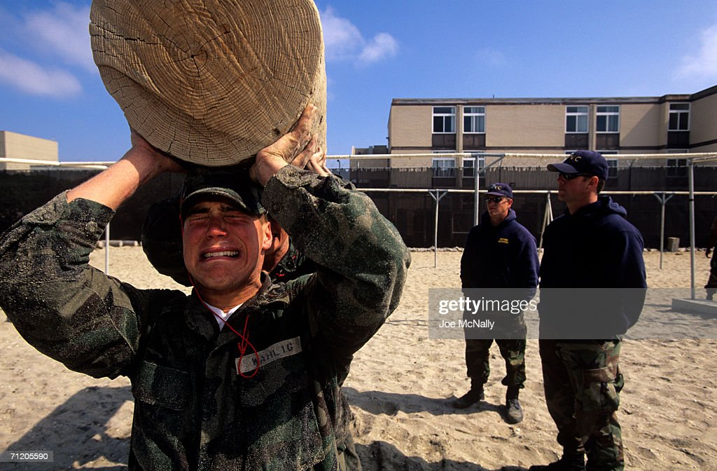 In this undated photo A Navy Seal recruit grimaces under the weight of 'Old Misery', a 350-pound log that he and his teammates must carry as punishment for being slow during Hell Week at Coronado Naval Amphibious Base near San Diego, California. Hell Week is the third week of training at the base and consists of five days and six nights of nonstop physical exercise. Less than half of the 60 recruits will last the week.