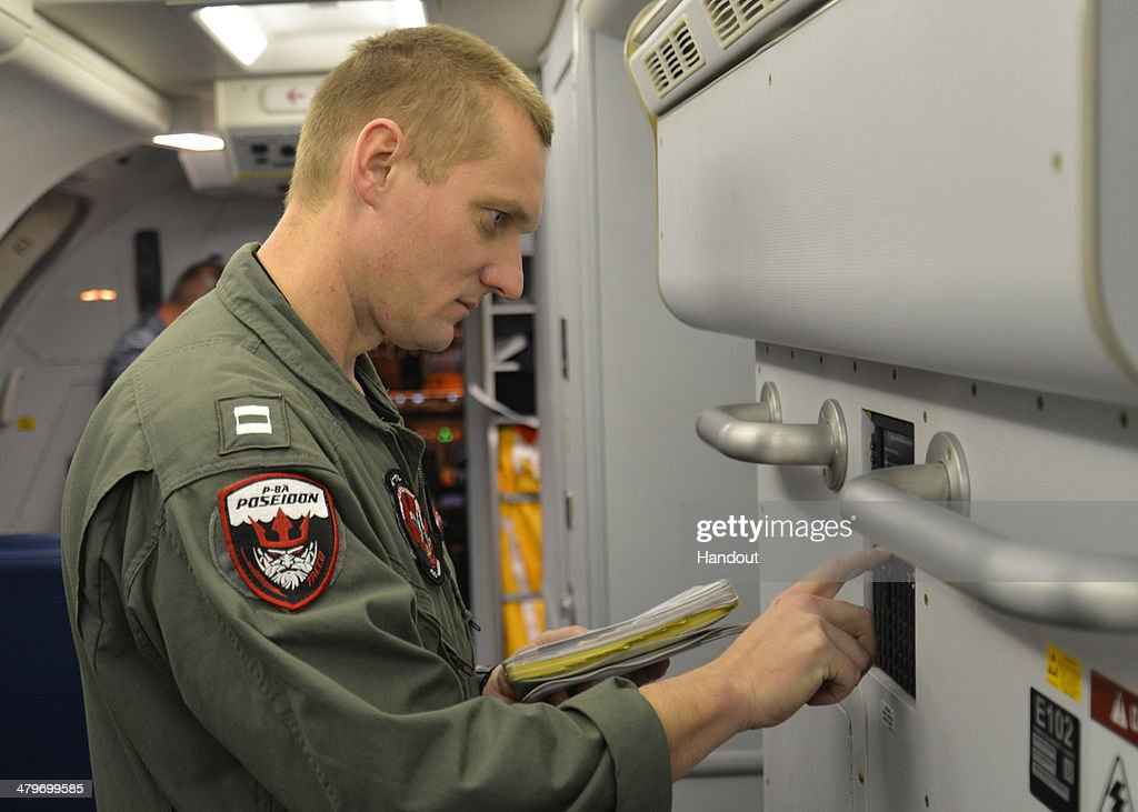 In this undated photo provided by the Navy Visual News Service, Lt. Joshua Mize, a tactical coordinator assigned to Patrol Squadron (VP) 16, completes his pre-flight checklist in a P-8A Poseidon before a mission to assist in search and rescue operations for Malaysia Airlines flight MH370 on March 19, 2014 in Perth, Australia. VP-16 is deployed in the U.S. 7th Fleet area of responsibility supporting security and stability in the Indo-Asia-Pacific region. Two objects possibly connected to the search for the passenger liner, missing for nearly two weeks after disappearing on a flight from Kuala Lumpur, Malaysia to Beijing, have been spotted in the southern Indian Ocean, according to published reports quoting Australian Prime Minister Tony Abbott.