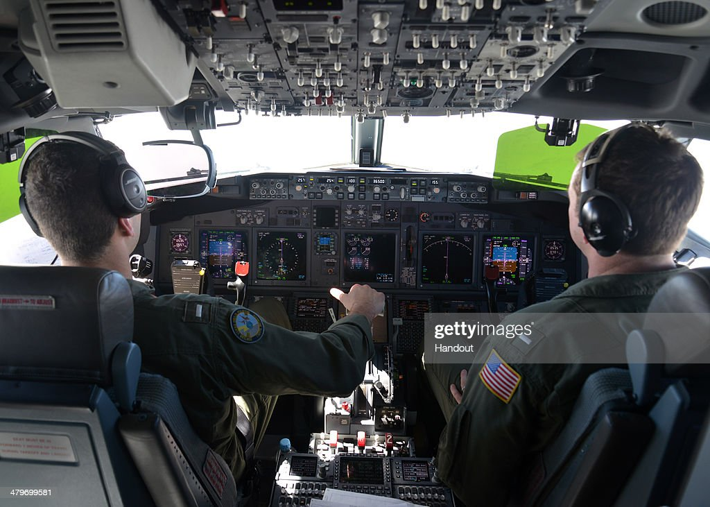 In this undated photo provided by the Navy Visual News Service, Lt. j.g. Kyle Atakturk, left, and Lt. j.g. Nicholas Horton, naval aviators assigned to Patrol Squadron (VP) 16, pilot a P-8A Poseidon during a mission to assist in search and rescue operations for Malaysia Airlines flight MH370 on March 19, 2014 over the Indian Ocean. VP-16 is deployed in the U.S. 7th Fleet area of responsibility supporting security and stability in the Indo-Asia-Pacific region. Two objects possibly connected to the search for the passenger liner, missing for nearly two weeks after disappearing on a flight from Kuala Lumpur, Malaysia to Beijing, have been spotted in the southern Indian Ocean, according to published reports quoting Australian Prime Minister Tony Abbott.