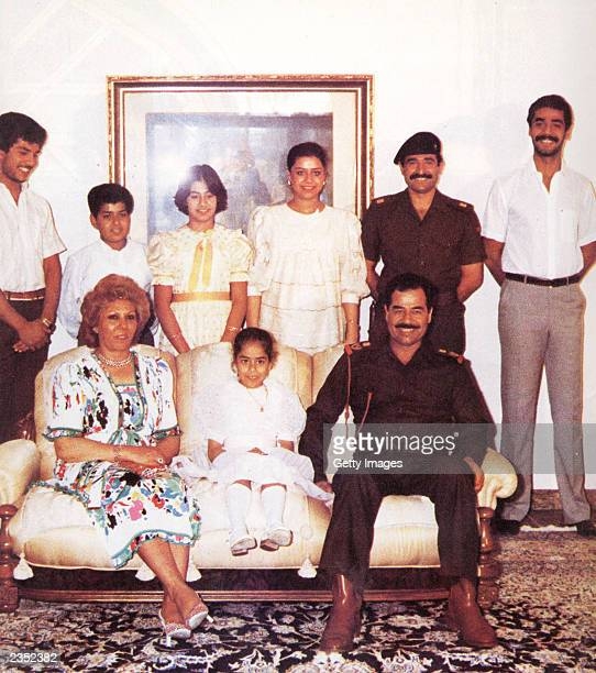 In this undated photo Saddam Hussein bottom right poses with his first wife Sajida his daughter Hala both seated From left standing are Hussein's son...