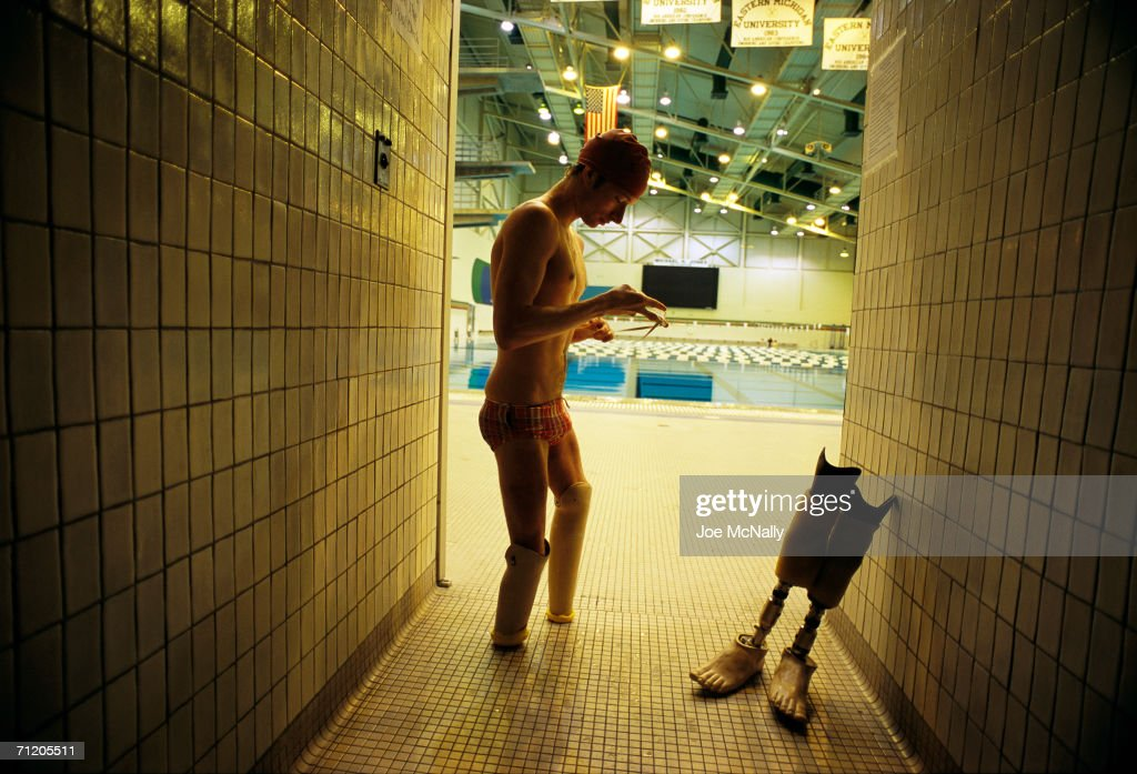 In this undated photo Swimmer Jason Wening shapes his own possibilities in Ypsilanti, Michigan. Despite the loss of his lower legs, he holds six world records in disabled competition. He swims eight miles a day in a Michigan pool. Says Wening, 'I never want to finish second.'