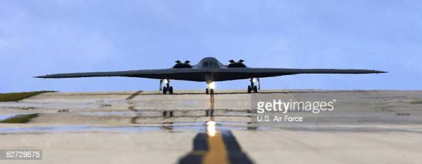 In this US Air Force handout A B2 Spirit Stealth Bomber from the 393rd Expeditionary Bomb Squadron taxis down the runway April 25 2005 at Andersen...