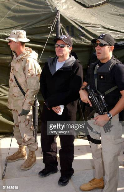 In this US Army handout released on December 15 2004 comedian and actor Robin Williams visits troops as part of a USO show to boost morale at Camp...
