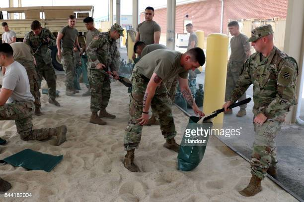 In this US Army handout Soldiers of 1st Battalion 30th Infantry Regiment 2nd Infantry Brigade Combat Team 3rd Infantry Division prepare for Hurricane...