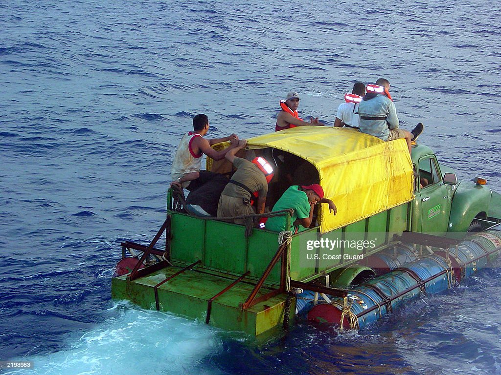 In this US Coast Guard handout Cuban migrants trying to reach the US coast in Florida ride a makeshift boat made out of a 1951 Chevrolet truck with a...