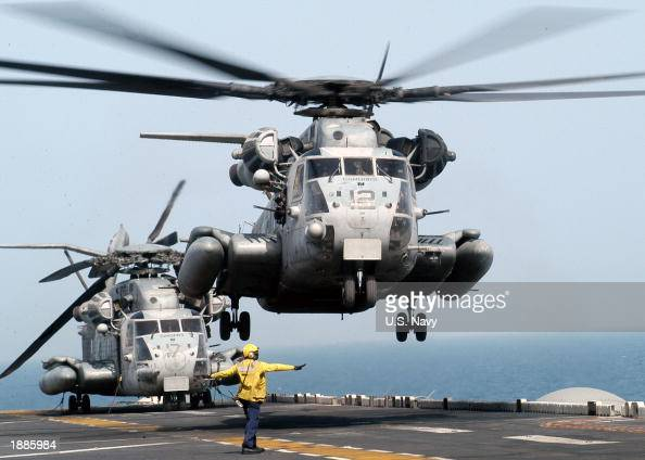 In this US Navy handout a CH53E Super Stallion helicopter lifts off the flight deck of the USS Kearsarge March 24 2003 in the Arabian Gulf Kearsarge...
