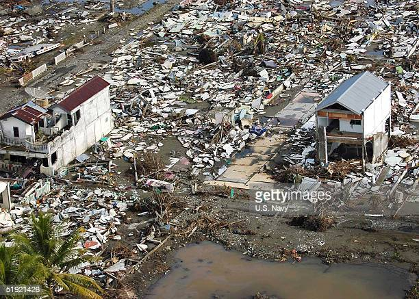 In this US Navy handout a coastal village is seen from the air January 6 2005 in Meulaboh Sumatra Indonesia An estimated 150000 were killed in the...