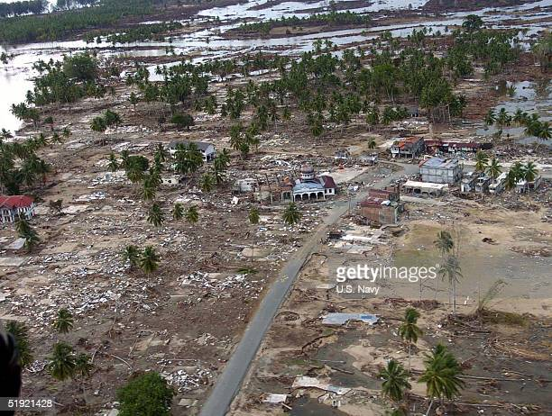 In this US Navy handout a coastal village is seen from the air January 6 2005 in BanTuan Sumatra Indonesia An estimated 150000 were killed in the...