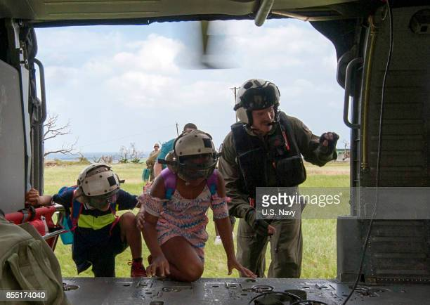In this US Navy handout Naval Aircrewman 2nd Class Brandon Larnard right assigned to Helicopter Sea Combat Squadron 22 attached to the amphibious...