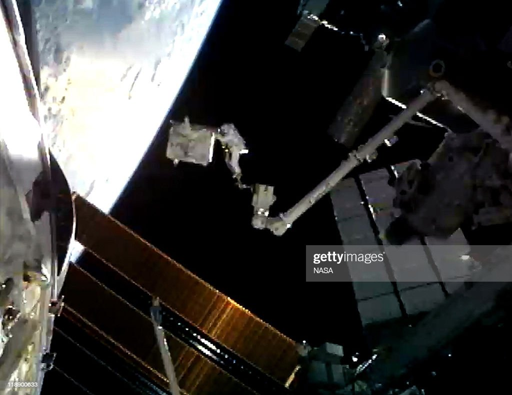 In this video screen grab provided by the National Aeronautics and Space Administration (NASA), NASA astronaut Ronald Garan attached to the Canada Arm 2 moves a failed ammonia pump module from a storage platform on the International Space Station to the cargo bay of the space shuttle Atlantis during a planned six-and-a-half-hour spacewalk July 12, 2011 in space. This is the 160th spacewalk devoted to station assembly and maintenance since construction began in 1998. Space shuttle Atlantis has embarked on a 12-day mission to the International Space Station where it will deliver the Raffaello multi-purpose logistics module packed with supplies and spare parts. This will be the final launch of the space shuttle program, which began on April 12, 1981 with the launch of Colombia.