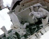 In this video screen grab provided by the National Aeronautics and Space Administration NASA astronaut Ronald Garan attached to the Canada Arm 2...