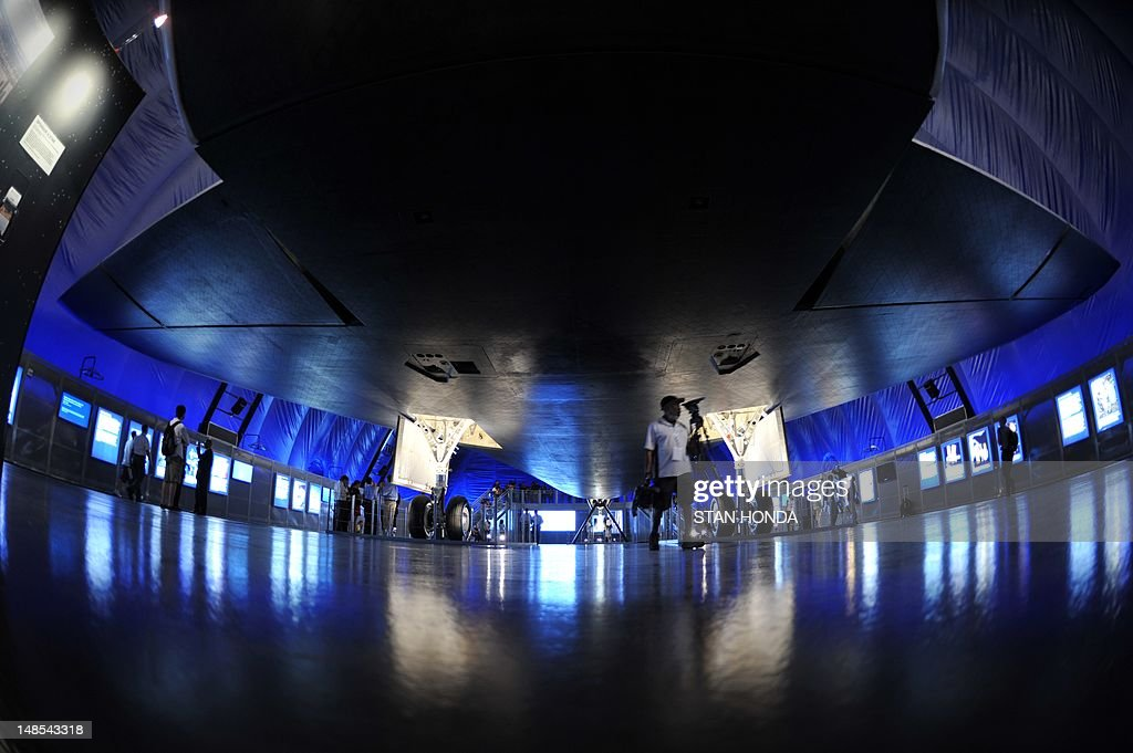 In this view from underneath the rear section, the Space Shuttle Enterprise seen on display at the Intrepid Sea, Air & Space Museum's Space Shuttle Pavilion during a press preview July 18, 2012 in New York. The exhibit will officially open to the public July 19. AFP PHOTO/Stan HONDA