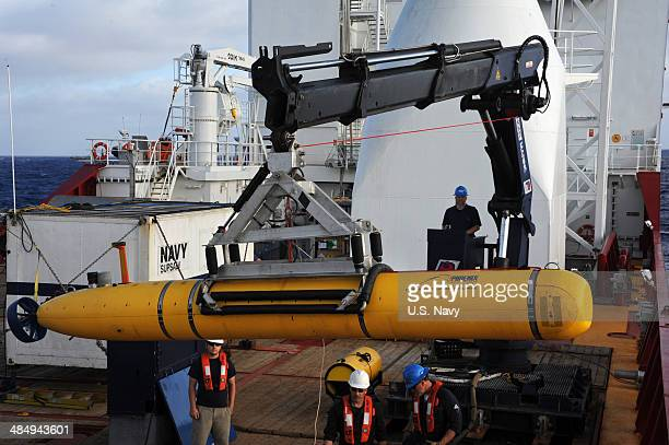 In tis handout from the US Navy Operators aboard Australian Defense Vessel Ocean Shield move the US Navy's Bluefin 21 autonomous underwater vehicle...