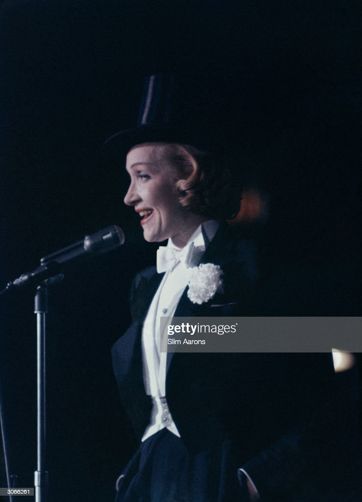 In top hat and tails Marlene Dietrich (Maria Magdalene von Losch) (1904 - 1992) performs at an 'April in Paris' ball in New York.